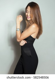 beautiful asian woman with wrist watch