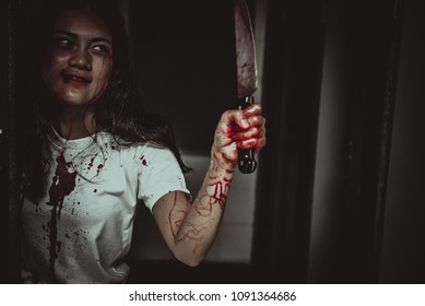 Beautiful asian woman,Murder crime concept,Blood on the body,Horror scene
