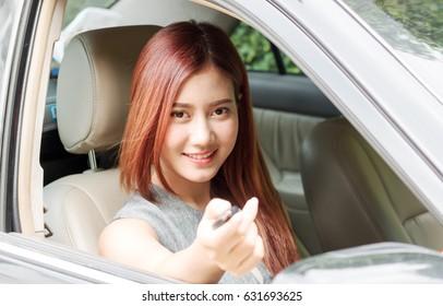 beautiful asian women give car key