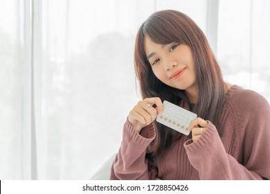 beautiful Asian women holding Birth control pill