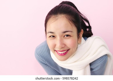 Beautiful asian women with pink background