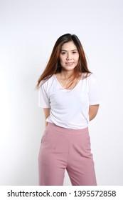 Beautiful Asian Women Portrait smiling wearing white t shirt and pink pant long brown hair natural make up
