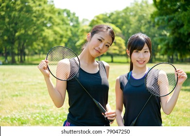 beautiful asian women with racket in the park