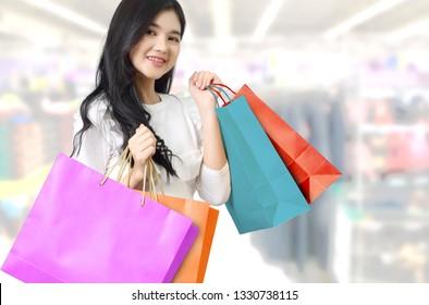 beautiful asian women shopping and holding her bags