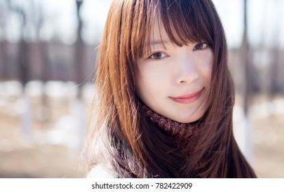 Beautiful Asian women smiling in the park