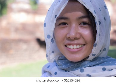 Beautiful Asian women wearing a head scarf for protection a sunlight