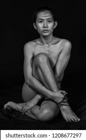 Beautiful Asian yang womwn of nude on a black background.Art nude.Black and white.