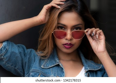 Beautiful asian young lady model with sunglass