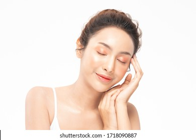Beautiful Asian young woman close her eyes touching soft cheek smile with clean and fresh skin Happiness and cheerful with positive emotional,isolated on white background,Beauty and Cosmetics Concept