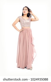 Beautiful Asian Young Woman full body posing in Metallic silver Sleeveless Top and  pleated maxi skirt isolated on white background.