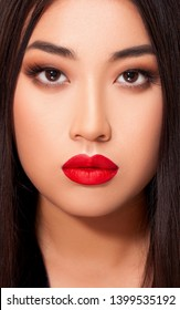 Beautiful Asian young Woman Makeup. Sexy red Lips. red matte lips. Perfect skin. Beauty and Make-up Portrait. Close-up. Fashion and beauty. Isolated. - Image
