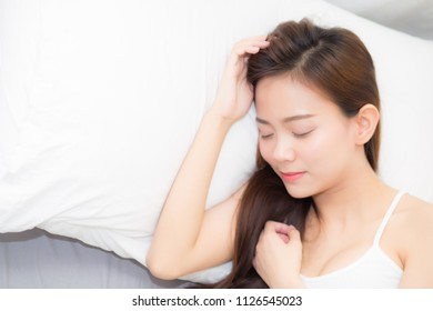 Beautiful asian young woman sleeping lying in bed with head on pillow comfortable and happy. girl with relax for health concept.