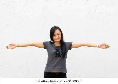 beautiful asian young woman spread her arms wide open