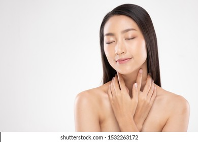 Beautiful Asian young woman touching neck smile with clean and fresh skin Happiness and cheerful with positive emotional,isolated on white background,Beauty and Cosmetics Concept