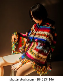Beautiful Asian young  woman warm sweater pink cold