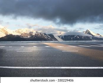 beautiful asphalt road in snow mountain area