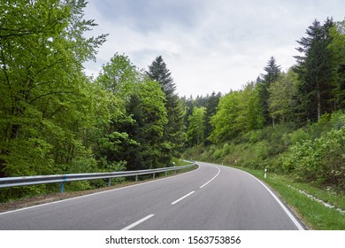 Beautiful asphalt road with turns through the Schwarzwald forest in Germany
