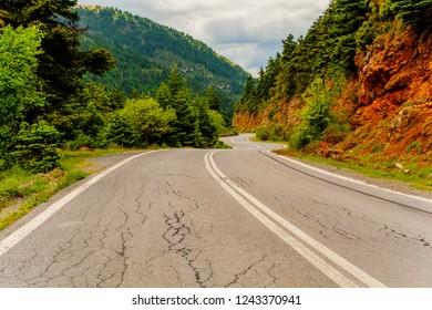 Beautiful asphalt rural road in Kalavryta, Achaia, Greece leading through a forest
