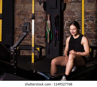 Beautiful athlete doing some rowing practice