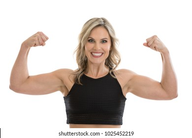 Beautiful athletic blond mid 30s woman, fit and healthy, flexing bicep muscles isolated on a white background