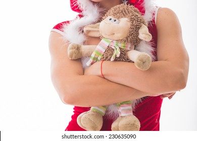 Beautiful, athletic blonde in Christmas suit with toy lamb, symbol of the year.Sport, fitness, new year, christmas, sheep  - the concept of the Christmas holidays.