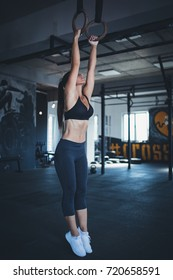 Beautiful athletic woman - fitness workout in gym.