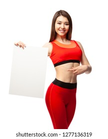 Beautiful athletic woman holding a poster and showing it.