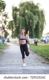 Beautiful athletic woman running outdoors
