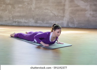 Beautiful athletic young female make yoga asana low cobra.