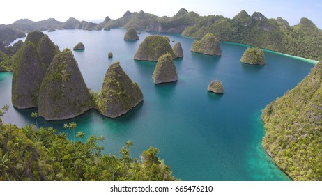 Beautiful atolls, unique rock island and pristine beach, wayag, raja ampat, west papua, indonesia