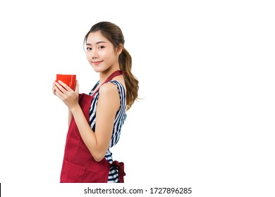 beautiful attractive asian female woman coffeeshop owner wear apron casual dress hand hold coffee dink smile with confident and cheerful welcome isolate white background
