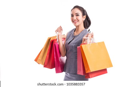 Beautiful Attractive Asian Woman smile and holding shopping bags feeling so happiness and enjoy with black Friday sale in Shopping mall,isolated on white background,Shopping Concept