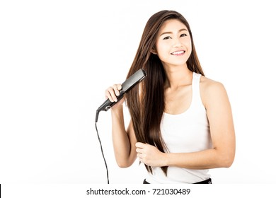 Beautiful Attractive Asian woman smile and holding Hair straighteners feeling so confident and happiness,Isolated on white background,Haircare Concept