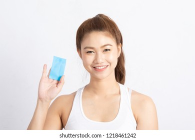 Beautiful Attractive Asian woman using Facial oil clean film to removal oil on face for face fresh skin feeling so fresh and clean,Beauty Concept,Isolated on grey background