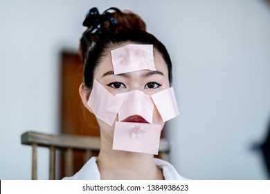 Beautiful Attractive Asian woman using Facial oil clean film to removal oily on face for face fresh skin feeling so fresh and clean,Beauty Concept