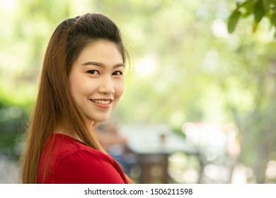 Beautiful Attractive Asian woman wearing red dress smile with cheerful and confident emotional