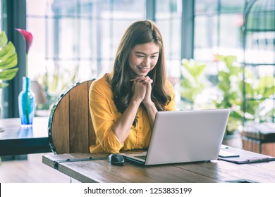 Beautiful Attractive Asian woman working with computer laptop and thinking to get ideas and requirement in Business startup feeling so happiness,Business Startup Concept