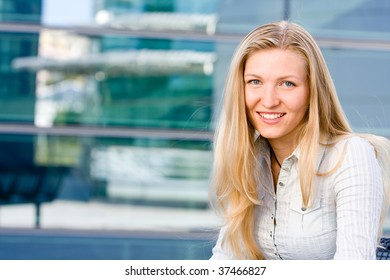 Beautiful attractive blonde business woman looking at you being sweet