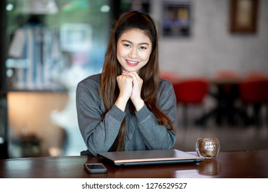 Beautiful Attractive Business Asian woman with laptop smile and have positive emotional feeling so happiness,Business Startup Concept