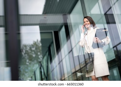 Beautiful and attractive businesswoman talking on cellphone