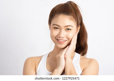 Beautiful Attractive Charming Asian young woman smile with white teeth and touching soft cheek feeling so happiness and cheerful with healthy skin,isolated on white background,Beauty Concept