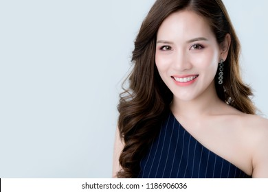 beautiful attractive elegance asian woman in blue dress  hand touch face model pose on  studio photo shoot isolate white background