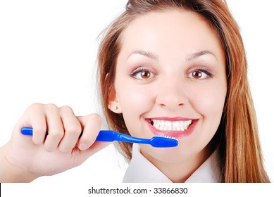 Beautiful attractive girl brushing her very  bright and white teeth
