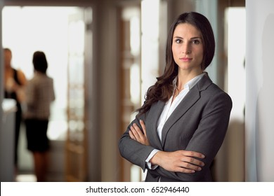 Beautiful attractive lawyer attorney with strong intense serious expression, legal representative