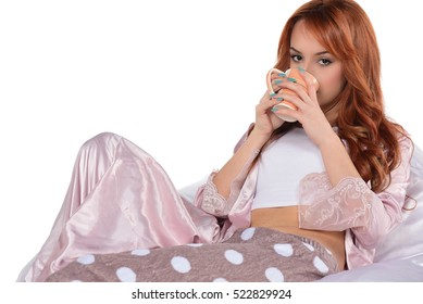 beautiful attractive redhead girl holding, drinking cup of tea, coffee. drinking coffe. isolated on white