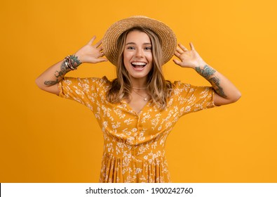beautiful attractive stylish woman in yellow dress and straw hat posing on yellow background isolated happy smiling face expression summer fashion style trend