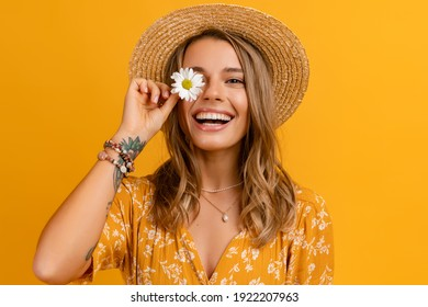 beautiful attractive stylish woman in yellow dress and straw hat holding daisy flower romantic mood posing on yellow background isolated in love summer fashion trend style, natural look - Shutterstock ID 1922207963