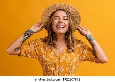 beautiful attractive stylish woman in yellow dress and straw hat posing on yellow background isolated happy smiling face expression white teeth, summer fashion style trend