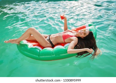Beautiful, attractive woman enjoying in the pool