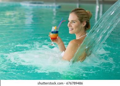Beautiful attractive woman enjoying time in pool